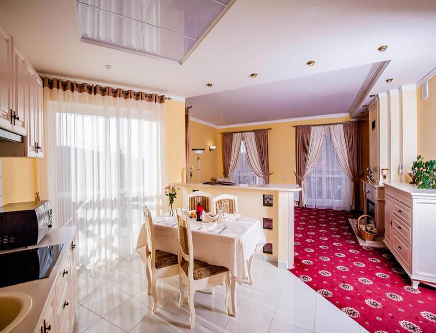 Отель Респект Сходница Фото - Номер апартаменты - Гостиная.