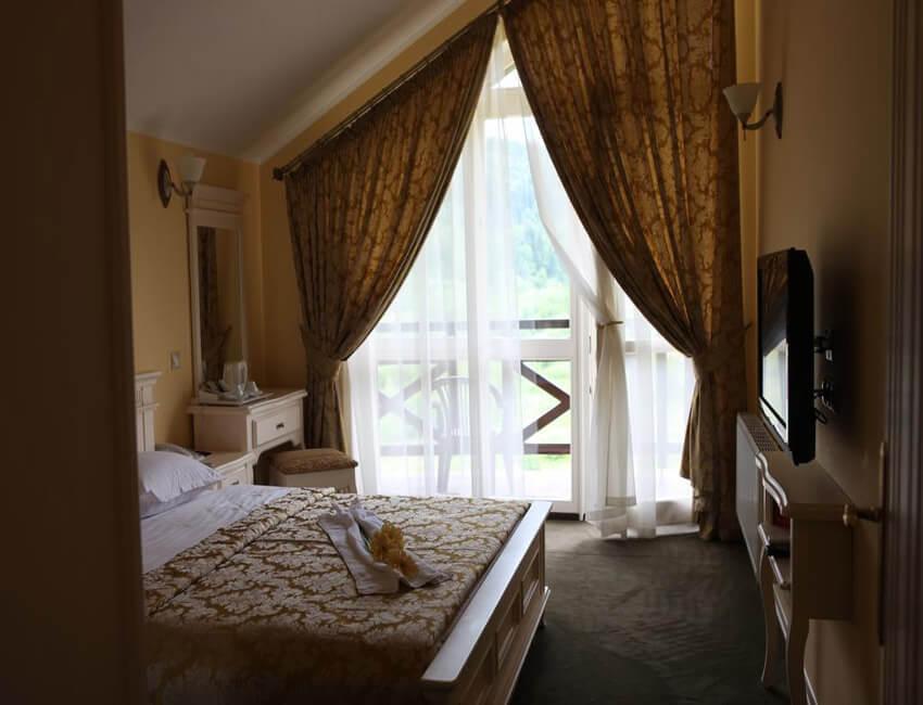 Отель Респект Сходница Фото - Номер люкс - Спальня.