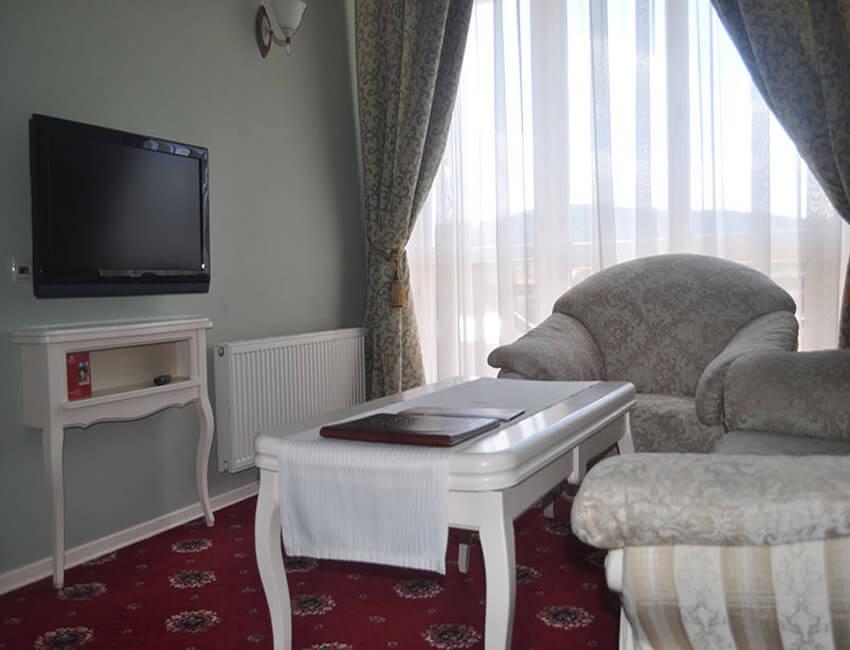 Отель Респект Сходница Фото - Номер люкс панорамный - Столик.