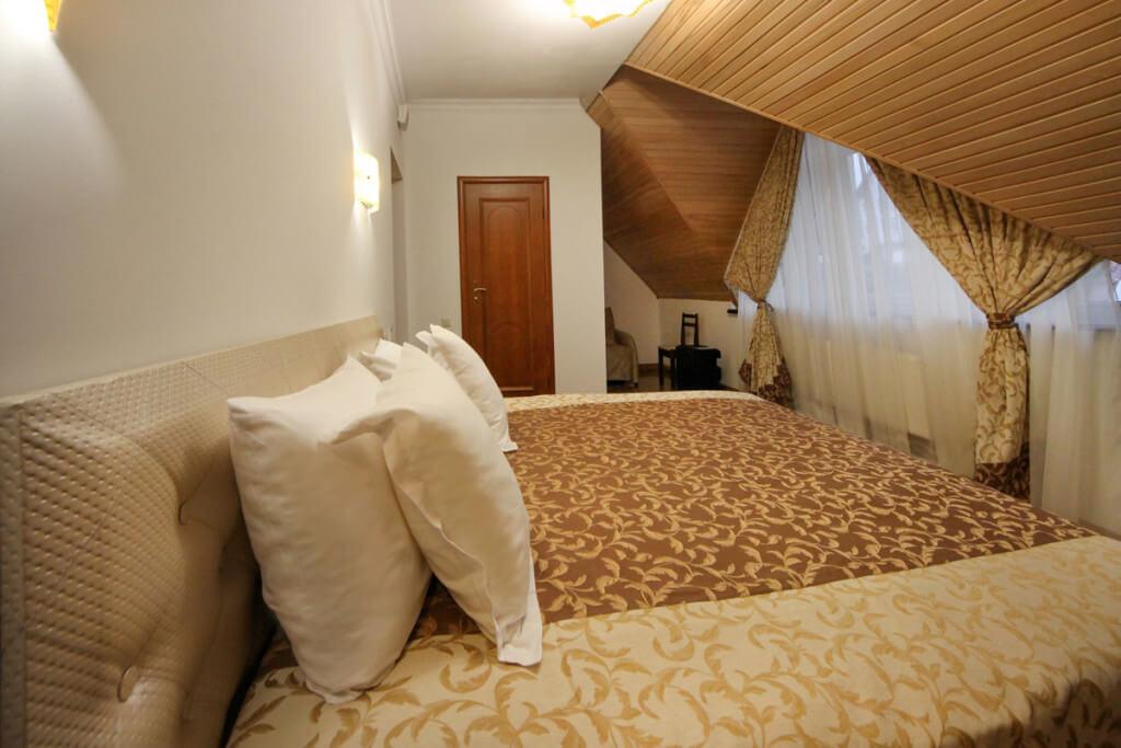 Отель Дианна Сходница Фото - Номер стандарт комфорт - Кровать в спальне