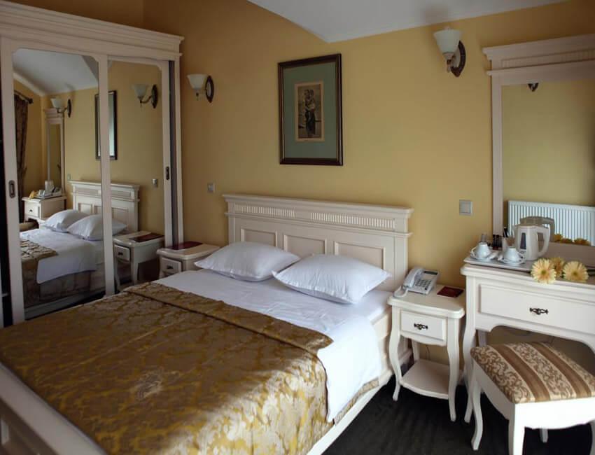 Отель Респект Сходница Фото - Номер стандарт улучшенный - Спальня.