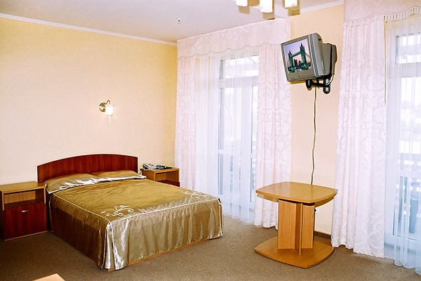Отель Мариот Трускавец Номер - люкс - Кровать.