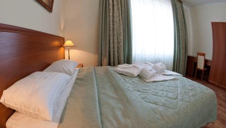 Отель РеВита Номер 2-комнатный люкс - Кровать.