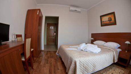 Отель РеВита Номер Стандарт 1-местный - Спальня.