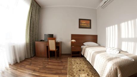 Отель РеВита Номер Стандарт 1-местный - Кровать.