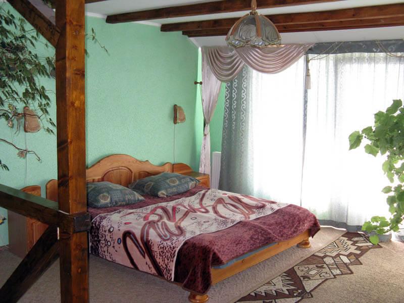 Ориана Трускавец Номер Люкс 2-комнатый - Кровать.