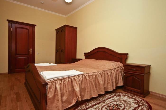 Отель Парк Трускавец Номер Люкс - Кровать.