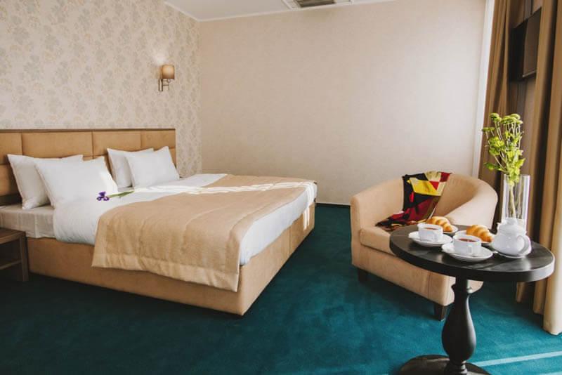 Отель Алькор Номер Люкс - Кровать.