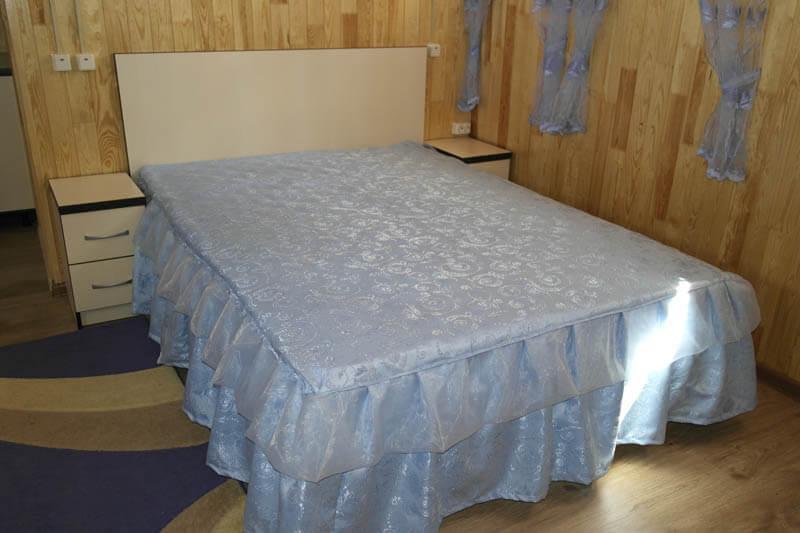 Номер Голубая Лагуна Фото - Кровать.